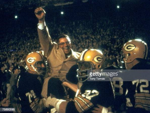 Green Bay Packers Hall of Fame head coach Vince Lombardi is carried off the field by his players after a 3427 win over the Dallas Cowboys in the 1967...