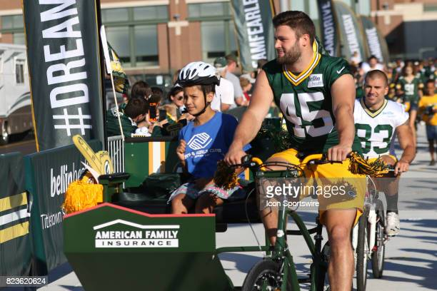 Green Bay Packers linebacker Vince Biegel takes a fan for a ride during Green Bay Packers Training Camp on July 27 2017 at Ray Nitschke Field in...