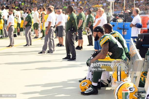 Green Bay Packers players sit in protest during the national anthem prior to the game against the Cincinnati Bengals at Lambeau Field on September 24...
