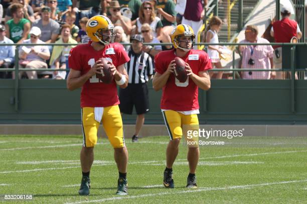 Green Bay Packers quarterback Aaron Rodgers and Green Bay Packers quarterback Joe Callahan pass in tandem during Green Bay Packers training camp at...