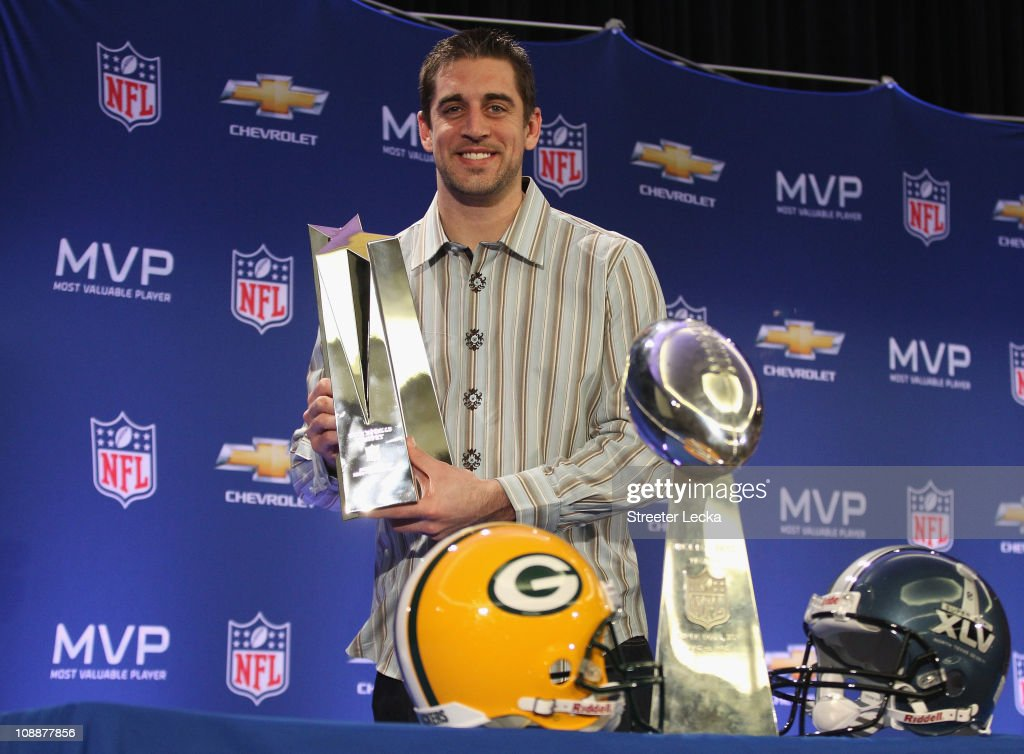 Green Bay Packers quarterback Aaron Rodgers poses with the MVP trophy after speaking to the media during a press conference at Super Bowl XLV Media Center on February 7, 2011 in Dallas, Texas.