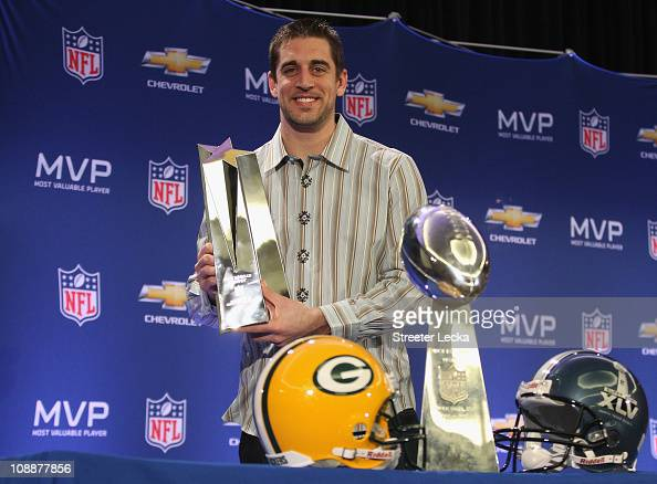 Green Bay Packers quarterback Aaron Rodgers poses with the MVP trophy after speaking to the media during a press conference at Super Bowl XLV Media...