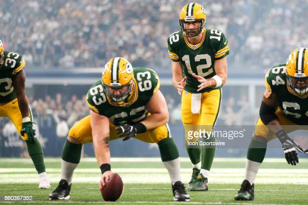 Green Bay Packers quarterback Aaron Rodgers waits for the snap from center Corey Linsley during the football game between the Green Bay Packers and...