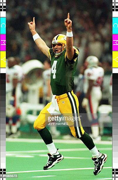 Green Bay Packers quarterback Brett Favre celebrates after throwing a touchdown pass to wide receiver Antonio Freeman during second quarter action at...