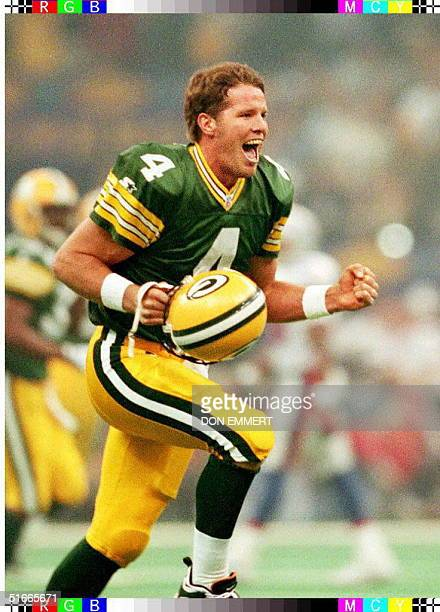 Green Bay Packers quarterback Brett Favre celebrates his first quarter touchdown pass to Andre Rison 26 January against the New England Patriots in...