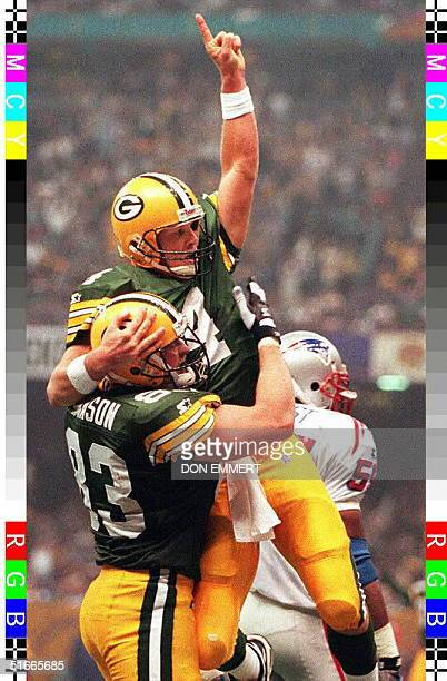 Green Bay Packers quarterback Brett Favre is hoisted in the air by teammate Jeff Thomason after Favre ran for a touchdown to give Green Bay a 2714...