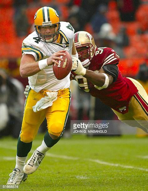 Green Bay Packers' quarterback Brett Favre is pressured by San Francisco 49ers' defensive tackle Andre Carter during the second quarter 15 December...