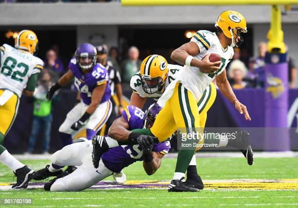 Green Bay Packers quarterback Brett Hundley breaks free from Minnesota Vikings defensive end Danielle Hunter during a NFL game between the Minnesota...