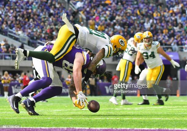 Green Bay Packers safety Ha Ha ClintonDix breaks up a pass intended for Minnesota Vikings tight end Kyle Rudolph during a NFL game between the...