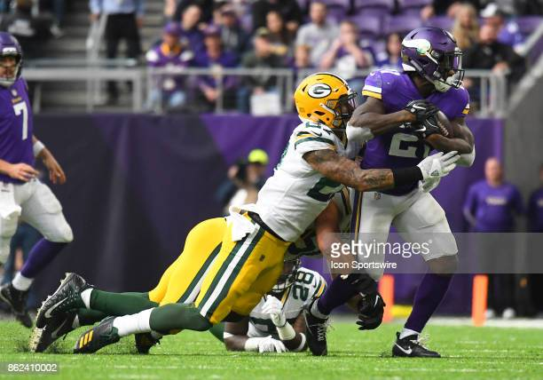 Green Bay Packers safety Josh Jones wraps up Minnesota Vikings running back Jerick McKinnon during a NFL game between the Minnesota Vikings and Green...