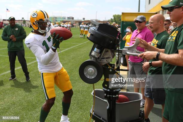 Green Bay Packers wide receiver Davante Adams makes a catch in front of staff and fans during Green Bay Packers training camp at Ray Nitshke Field on...
