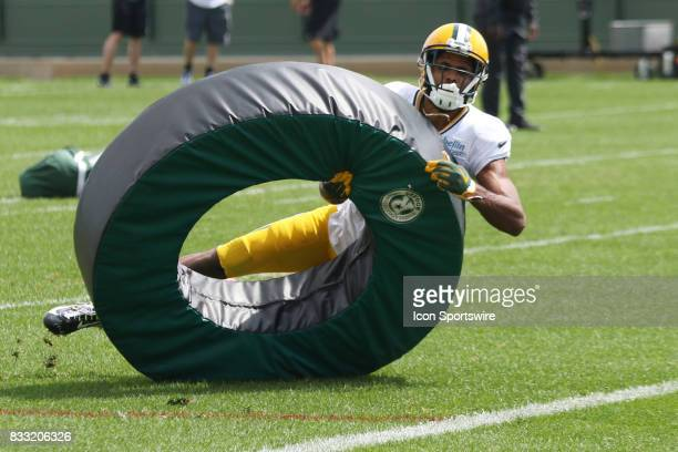 Green Bay Packers wide receiver Michael Clark runs a tackling drill during Green Bay Packers training camp at Ray Nitshke Field on August 16 2107 in...