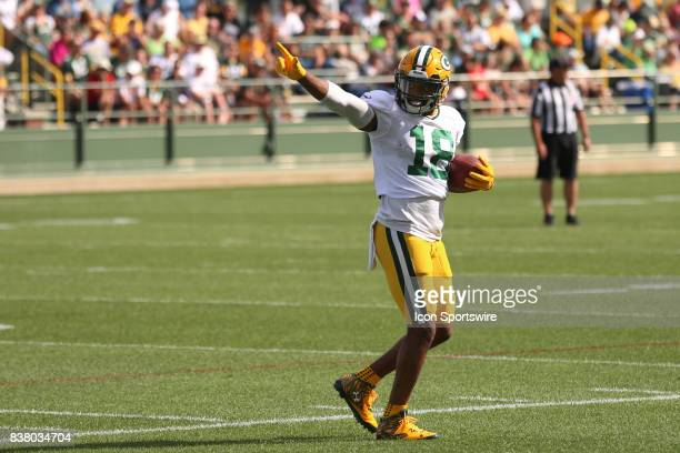 Green Bay Packers wide receiver Randall Cobb acknowledges fans singing him Happy Birthday during Packers training camp at Ray Nitschke Field on...