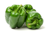 green bell peppers isolated on a plain white background