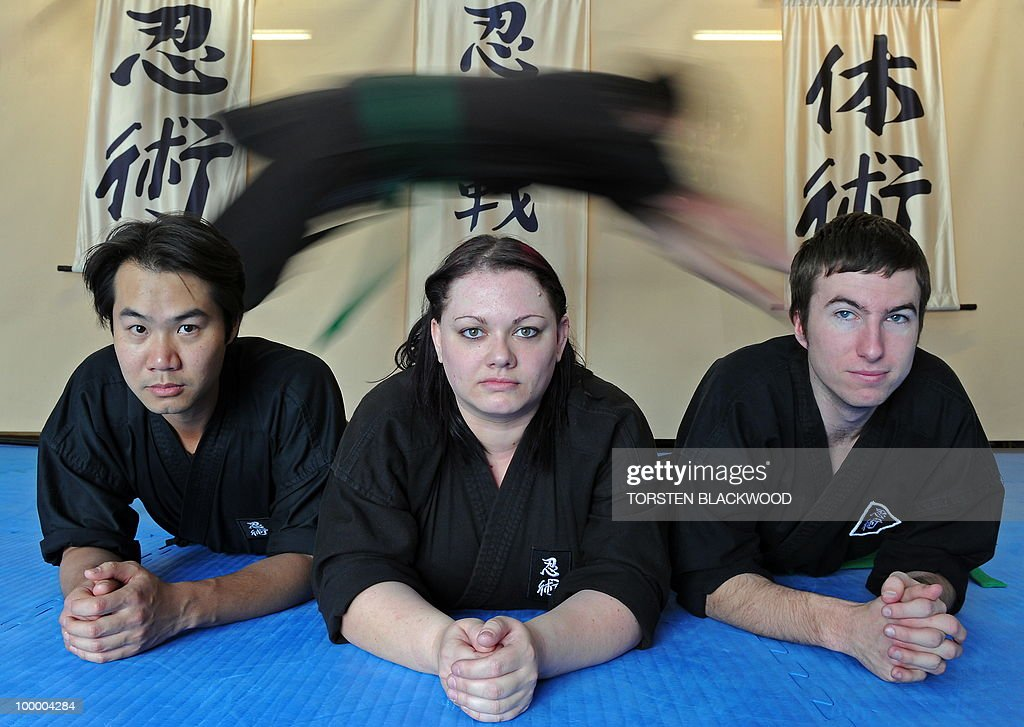 Green belt ninjas (L to R) Victor Le, Anj Taylor and Brendan Martin-Wein practice dive rolls at the Ninja Senshi Ryu (Ninja Warrior School) near Sydney on May 20, 2010. Instructor Kaylan Soto and his black-clad students have become local heroes after they saved a 27-year-old German medical student from three Australian muggers who struck outside their martial arts school. AFP PHOTO/Torsten BLACKWOOD