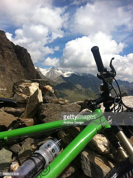 Green bike at transalp with view into a valley