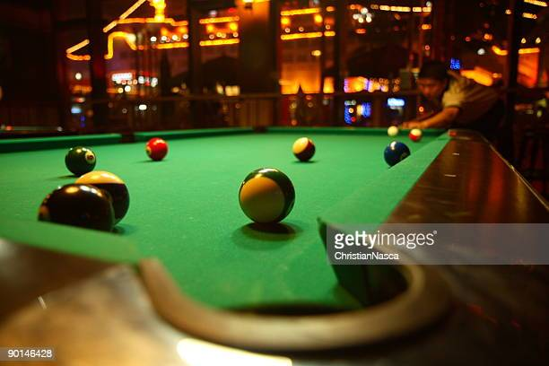 Green billiards table with pool balls