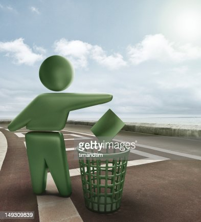 Green bin symbol on the seafront : Stock Photo