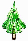 Green bottles arranged in shape of tree