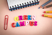 Green Campus. Wooden letters on the office desk, informative and communication background