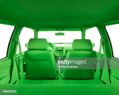 Green car, environment- In the back of the car