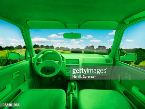 Green car, environment. (In landscape) : Stock Photo