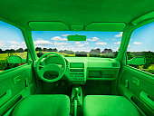Green car, environment. (In landscape)