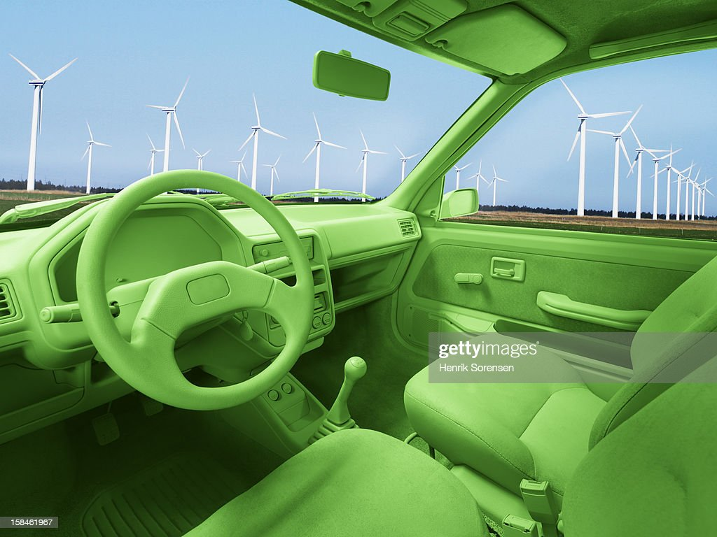 Green car, environment. (Wind mills) : Stock Photo