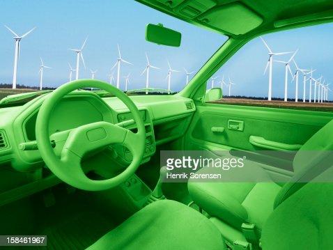 Green car, environment. (Wind mills) : Stock Photo