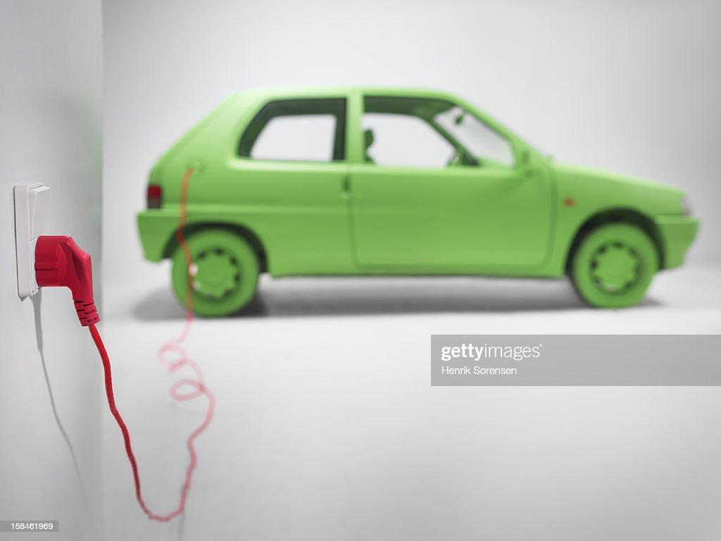 Green car, environment. (Electric car) : Stock Photo