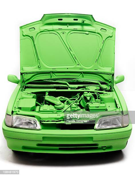 Green car, environment. (The front of the car)