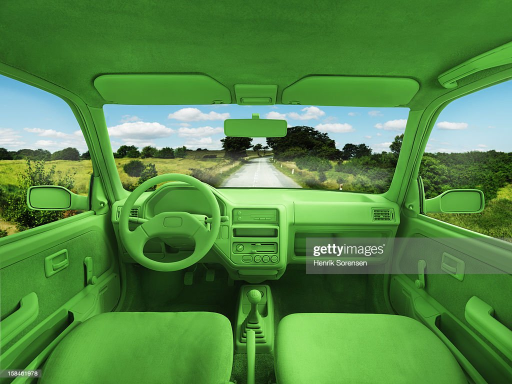Green car, environment. (On the road) : Stock Photo
