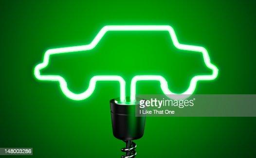 Green, car shaped energy saving eco lightbulb : Stock Photo