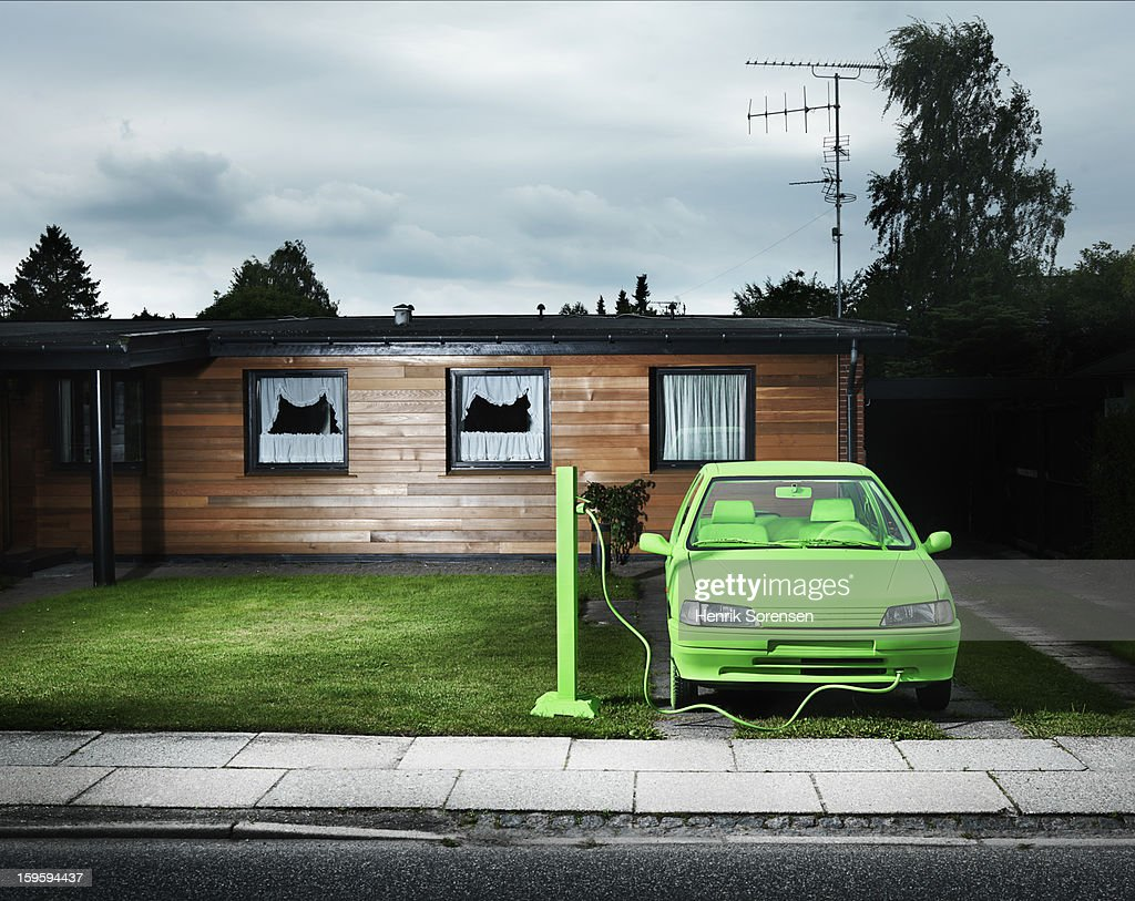 Green car, sustainable energy. (Charging) : Stock Photo