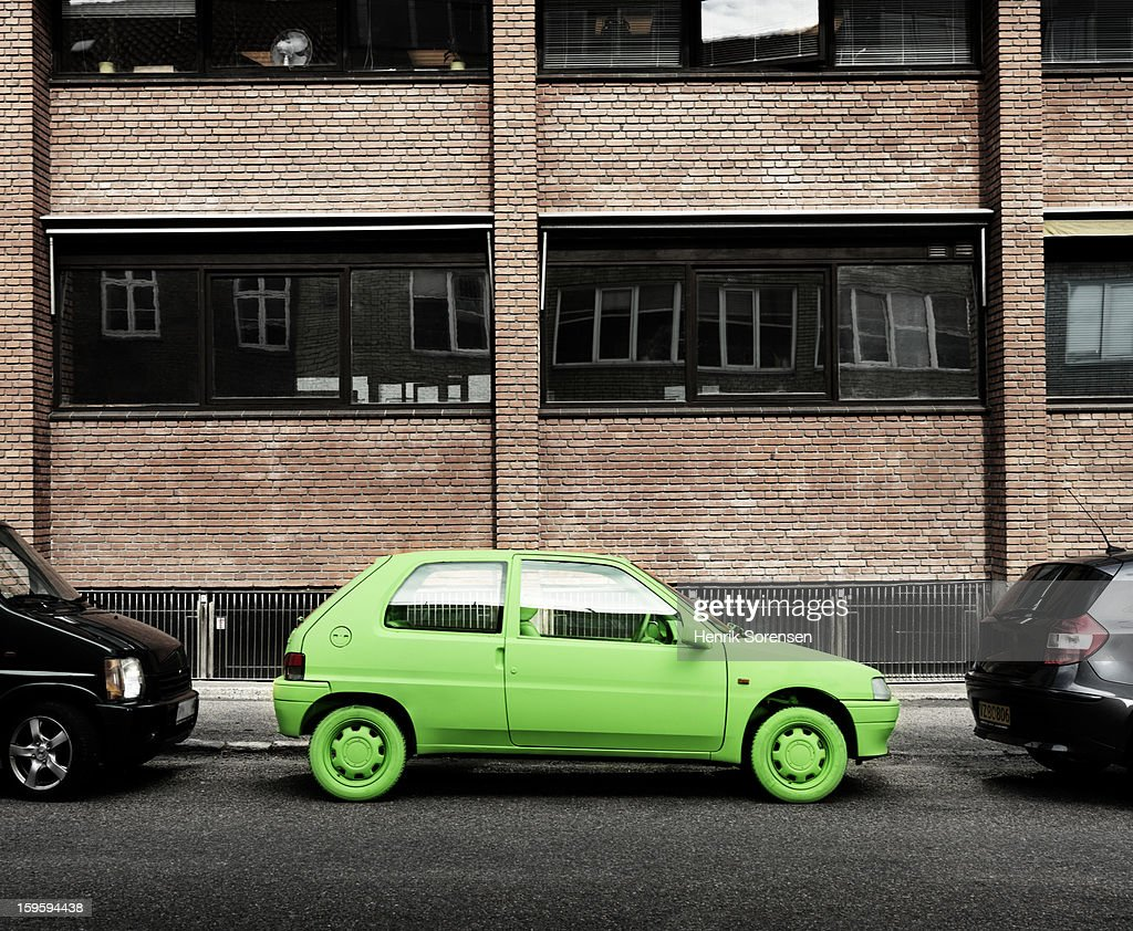 Green car, sustainable energy. (By sidewalk) : Stock Photo