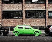 Green car, sustainable energy. (By sidewalk)