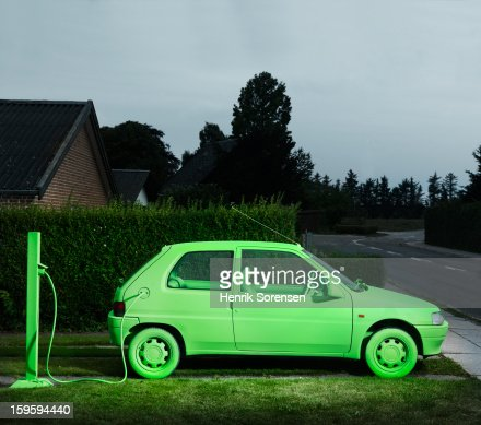 Green car, sustainable energy. (Charging)
