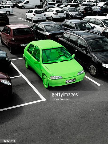 Green car, sustainable energy. (In parking lot)
