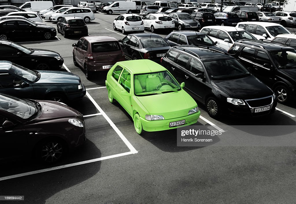 Green car, sustainable energy. (parking lot)