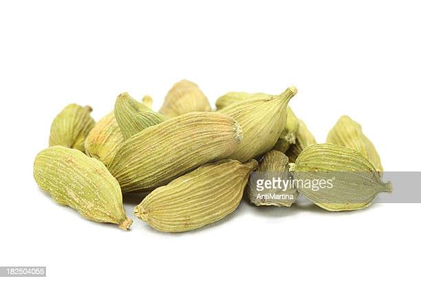 green cardamom seeds (elettaria cardamomum) isolated on white