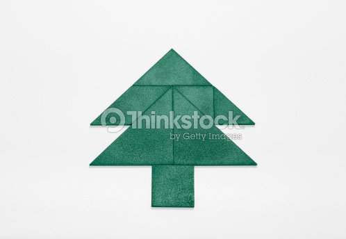 green christmas tree puzzle stock photo