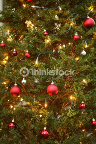 Green Christmas Tree With Red Baubles Stock Photo Thinkstock