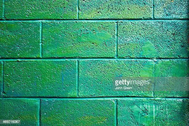 Green cinder block wall