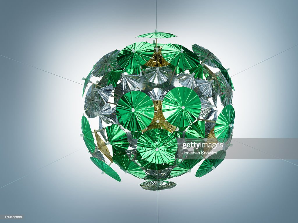 Green cocktail umbrellas arrangement : Stock Photo