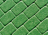Green color cobblestone pavement surface. abstract background and texture for design.