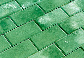 Green color cobblestone pavement texture. Abstract background and texture for design.
