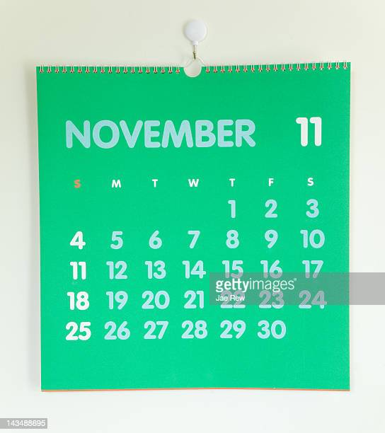 Green colored calendar on white wall