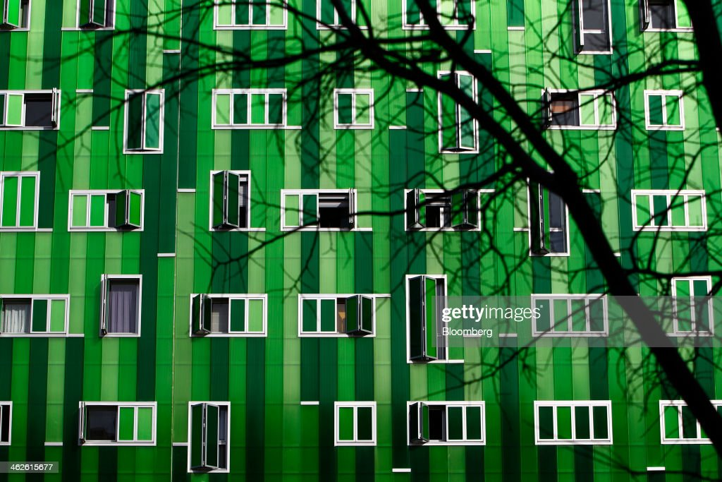 Green colored panels and window shutters cover the exterior of a residential apartment block in Madrid, Spain, on Monday, Jan. 13, 2014. Spain's rental market is growing as government-spending cuts, a 26 percent jobless rate and subdued mortgage lending make home buying more difficult. Photographer: Angel Navarrete/Bloomberg via Getty Images