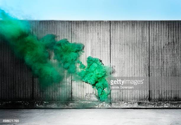 Green colored smoke in urban area