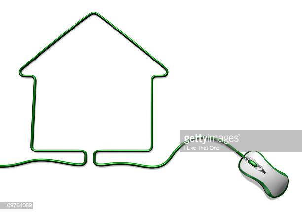 Green computer mouse with cable forming a house